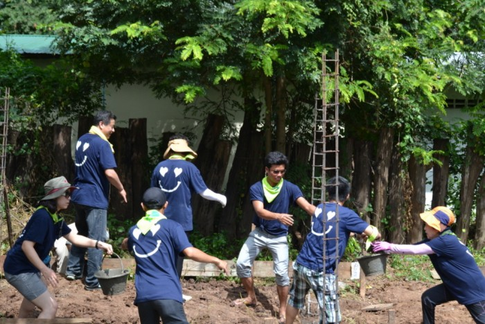 Volunteers from Korea help to build a school latrine